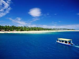 Boat in Lagoon, Plantation Island Resort, Fiji by Peter Hendrie