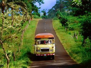 Bus Travelling on Island Road, Upolu, Samoa by Peter Hendrie