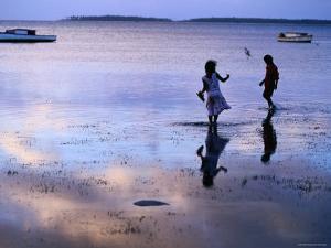 Children Standing in Shallow Tide, Tongatapu Island, Tongatapu Group, Tonga by Peter Hendrie