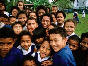 Group of Schoolchildren Smiling, Upolu, Samoa by Peter Hendrie