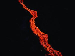 Lava Flow at Night, Kilauea, USA by Peter Hendrie