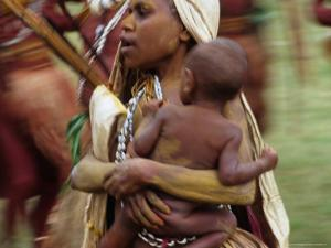 Mother Carrying Baby, Blur, Papua New Guinea by Peter Hendrie