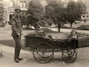Patient on Trolley at Reading War Hospital, Berkshire by Peter Higginbotham