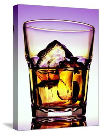 Glass of Whiskey with Ice Cubes by Peter Howard Smith