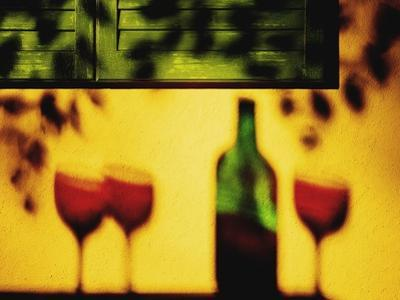 Shadow of Red Wine Bottle and Red Wine Glasses on Wall by Peter Howard Smith