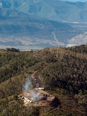 Smoke Rises from a Drilling Rig on the Roan Plateau by Peter M. Fredin