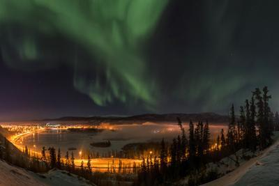 The Aurora Borealis Above the City Lights of Whitehorse by Peter Mather