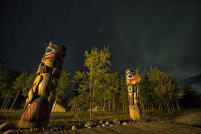 Totem Poles at Night. Tlingit Culture Symbols at the Community Visitor Interpretation Center by Peter Mather