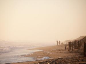 Fishermen on Beach at Sunrise by Peter Ptschelinzew
