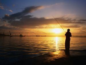 Fishing on Bahia De La Habana, Havana, Cuba by Peter Ptschelinzew