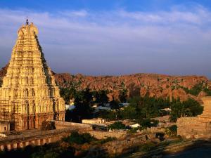 Overhead of Virupaksha Temple, Hampi Bazaar and Surrounding Hills from Hemakuta Hill, Hampi, India by Peter Ptschelinzew