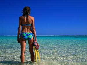 Woman Standing in Turquoise Bay, Ningaloo Marine Park, Australia by Peter Ptschelinzew