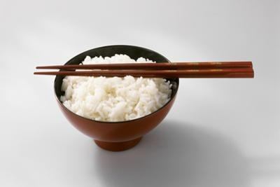 Boiled Basmati Rice in a Red Bowl with Chopsticks by Peter Rees