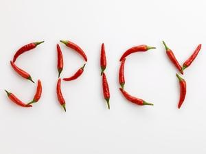 The Word 'SPICY' Written in Red Chillies by Peter Rees