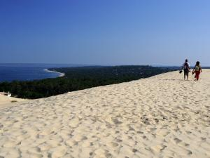 Couple Walking on the Dunes Du Pyla, Bay of Arcachon, Cote D'Argent, Aquitaine, France, Europe by Peter Richardson