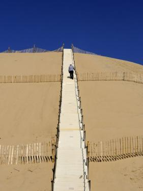 Man Climbing Steps Leading Up to Dunes Du Pyla, Bay of Arcachon, Cote D'Argent, Aquitaine by Peter Richardson