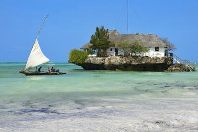 Tourist on a Traditional Dhow Boat, the Rock Restaurant, Bwejuu Beach, Zanzibar, Tanzania by Peter Richardson