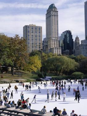 People Skating in Central Park, Manhattan, New York City, New York, USA by Peter Scholey