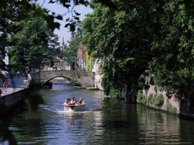 Tourists in Boat on Canal, Bruges, Belgium