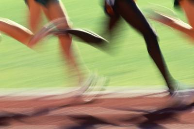 Runners Legs in Motion (Blurred Motion) by Peter Skinner