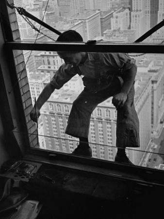 A Window Washer Cleaning the Windows by Peter Stackpole