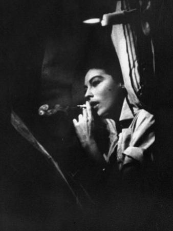 "Actress Ava Gardner Smoking a Cigarette in a Scene from the Film ""Mogambo"" by Peter Stackpole"