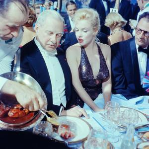 Ambassador Winthrop Aldrich Chats with Marilyn Monroe as Husband Arthur Miller Looks on, Paris Ball by Peter Stackpole
