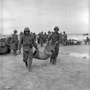 American Marines Carrying a Wounded Child to an Aid Station after the Invasion of Saipan by Peter Stackpole
