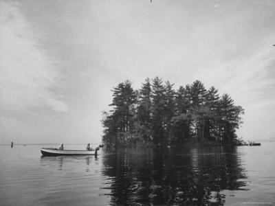 "Boating on Sebago Lake Past ""Keepsake"" Island by Peter Stackpole"