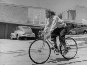 Composer Eden Ahbez Enjoying a Bike Ride by Peter Stackpole