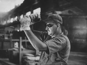 Dale Clover Skilled Steel Worker at Allegheny Ludlum Mill Uses Handled Test Spoon to Sample Steel by Peter Stackpole