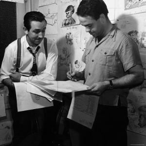 """Director Walt Disney Looking over Sketches from His Latest Picture """"Pinocchio."""" by Peter Stackpole"""