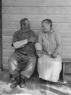 Elderly Couple Holding Hands by Peter Stackpole
