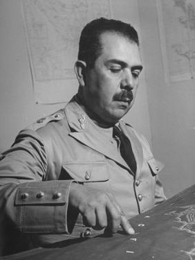 General Lazaro Cardenas, Pointing to a Map as His Continues to Work on a Stradegy by Peter Stackpole