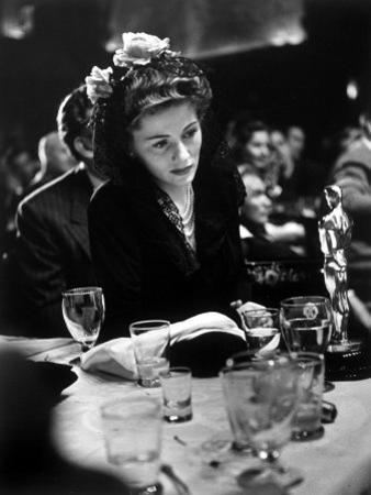 "Joan Fontaine Looking at the Best Actress Oscar She Won for Her Role in the Film ""Suspicion"" by Peter Stackpole"