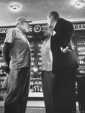 Noel Coward Chatting with Ernest Hemingway and Alec Guinness on Set Location at Sloppy Joe's Bar by Peter Stackpole
