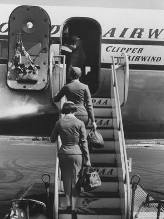 Stewardesses Arriving For Flight by Peter Stackpole