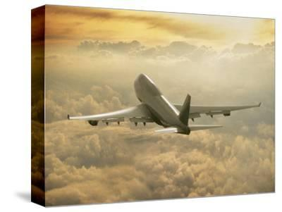 Jumbo Jet Above Clouds at 35,000 Feet by Peter Walton