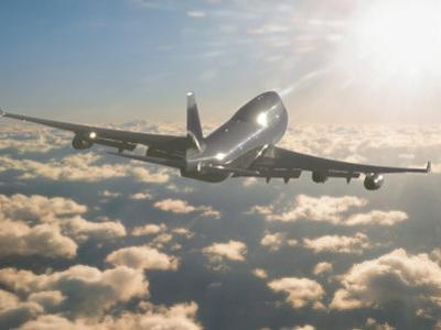 Jumbo Jet Above Clouds Into Sunlight by Peter Walton