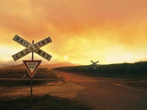Sugar Cane Rail and and Road Crossing at Sunset near Sarina, Queensland, Australia by Peter Walton Photography