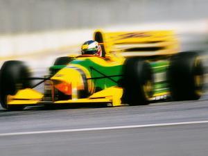 Yellow Race Car in Motion by Peter Walton