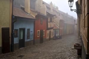 Czech Republic, Prague. Houses of Golden Little Street in Morning Fog by Petr Bednarik