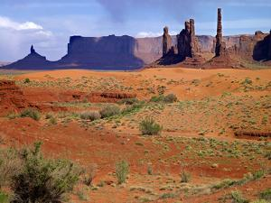 USA, Utah, Monument Valley. Totem Poles with a Sand Dune by Petr Bednarik
