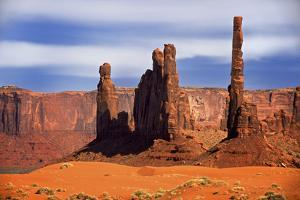 Utah, Monument Valley. Spires of Red Rock with a Sand Dune by Petr Bednarik