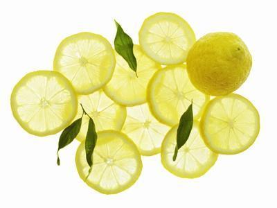 A Whole Lemon, Lemon Slices and Leaves