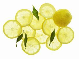 A Whole Lemon, Lemon Slices and Leaves by Petr Gross