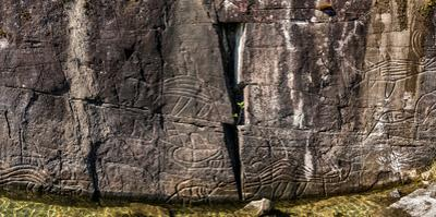 Petroglyphs on rock at Sproat Lake, Sproat Lake Provincial Park, Vancouver Island, British Colum...
