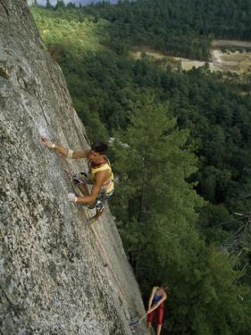 Climber Inches up a 600-Foot Climb Called Inferno, White Horse Ledge, New Hampshire by Phil Schermeister