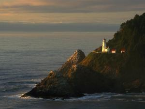 Distant View of the Heceta Head Lighthouse on the Oregon Coast by Phil Schermeister