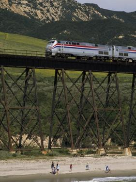 The Coast Starlight Passes over a Trestle Bridge near Santa Barbara, California by Phil Schermeister